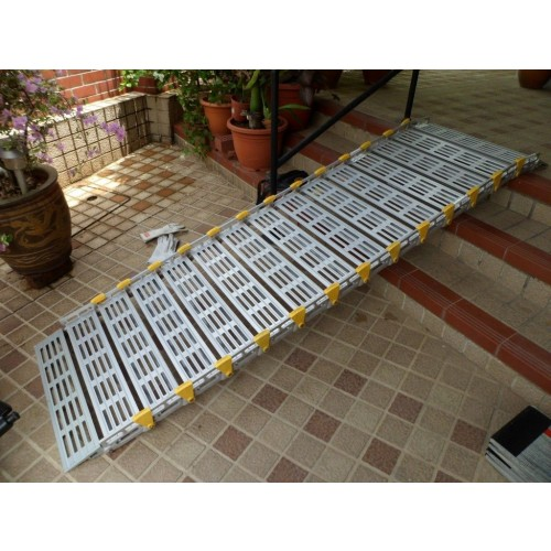 Roll-A-Ramp  Aluminum Roll-Up Ramp Extended from Stairs