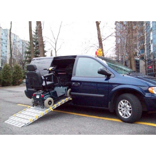 Scooter being put into Car using a Roll-A-Ramp  Aluminum Roll-Up Ramp