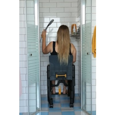 Woman sitting in Seatara WheelAble Folding Commode Shower Wheelchair while showering