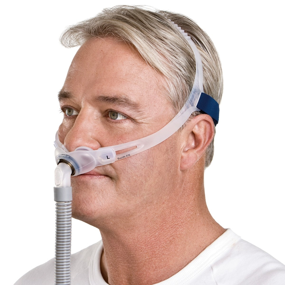 Man wearing a Swift FX Nasal Pillow CPAP Mask with Headgear