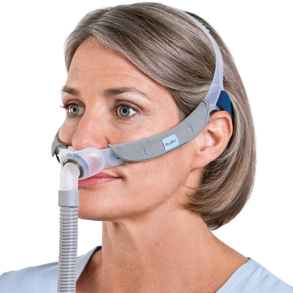 Woman wearing a Swift FX Nasal Pillow CPAP Mask with Headgear