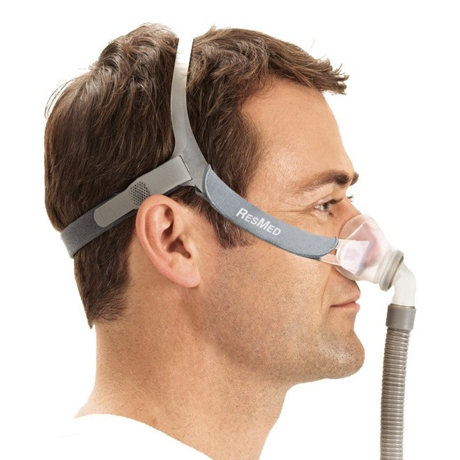 Man wearing a Swift FX Nano Nasal CPAP Mask with Headgear