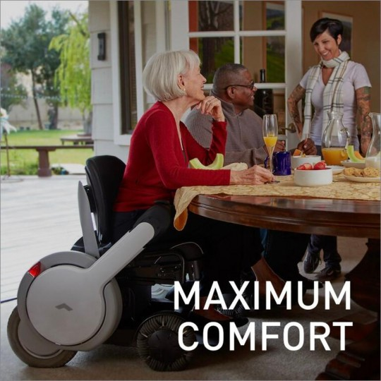 Woman sitting in WHILL Model M Personal EV Power Wheelchair