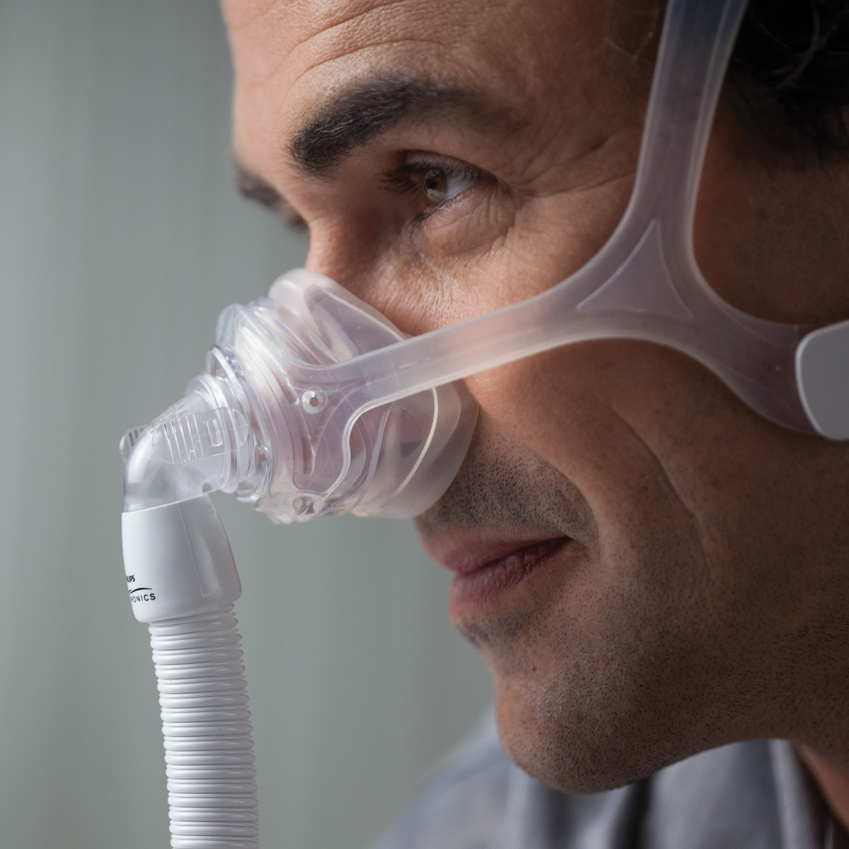 Closeup of man wearing a Wisp Nasal CPAP Mask with Headgear