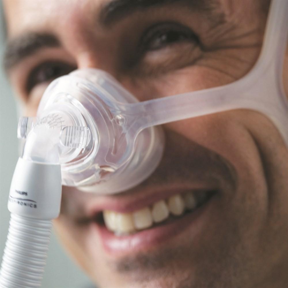 Man wearing a Wisp Nasal CPAP Mask with Headgear