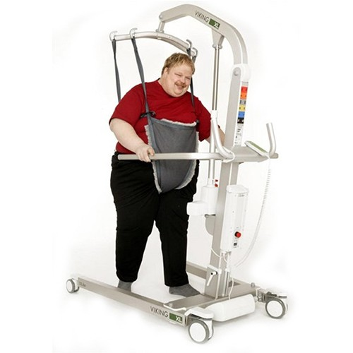Woman standing using a Liko Viking® L/XL Patient Lift