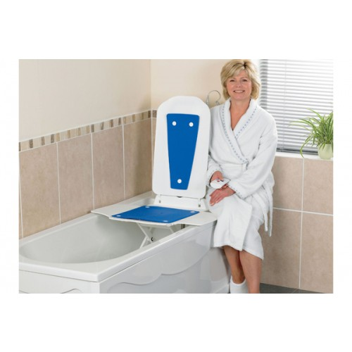 Woman sitting on Bathtub with a Bathmaster Deltis Reclining Bath Lift