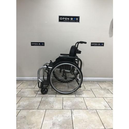 Side view of Ki Mobility Rogue TTL Ultralight Rigid Wheelchair