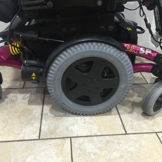 Wheels of Used Invacare TDX SP Power Wheelchair w/ Power Tilt & Recline