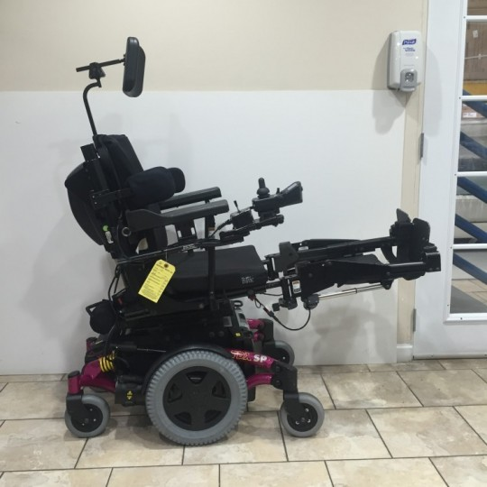 Side view of Used Invacare TDX SP Power Wheelchair w/ Power Tilt & Recline