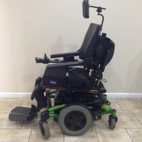 Side view of Used Invacare TDX SP Rehab Tilt Power Wheelchair