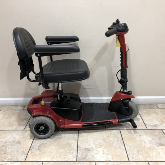 Side view of Used Pride Go-Go Ultra 3 Wheel Scooter
