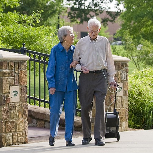 Man walking using a 3 Liter Continuous Portable Oxygen Concentrator Rental (6 Liter Pulse)