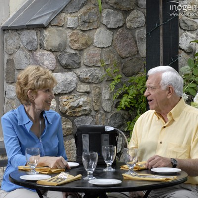 Man at dinner using a 5 Liter Pulse Portable Oxygen Concentrator Rental