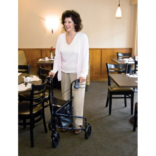 Woman walking with a Carex Trio Rolling Walker in a Restaurant