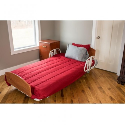 Comfort Wide EX5000 Expandable Width Long Term Care Low Bed with Red Covers and Pillows