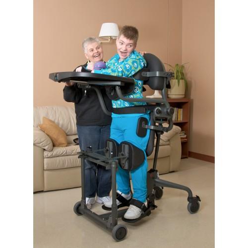 Child standing on a EasyStand Evolv Medium