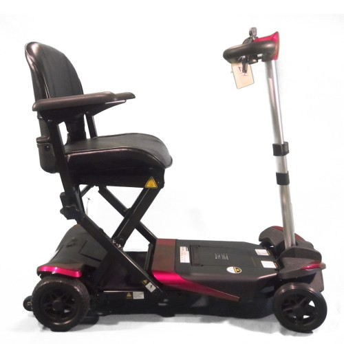 Side view of Pink Enhance Mobility Solax Transformer Automatic Folding Scooter