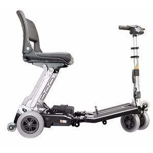 Side view of White FreeRider Luggie Classic Folding Mobility Scooter