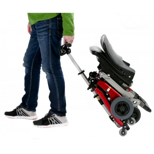 Person Lugging a FreeRider Luggie Classic Folding Mobility Scooter