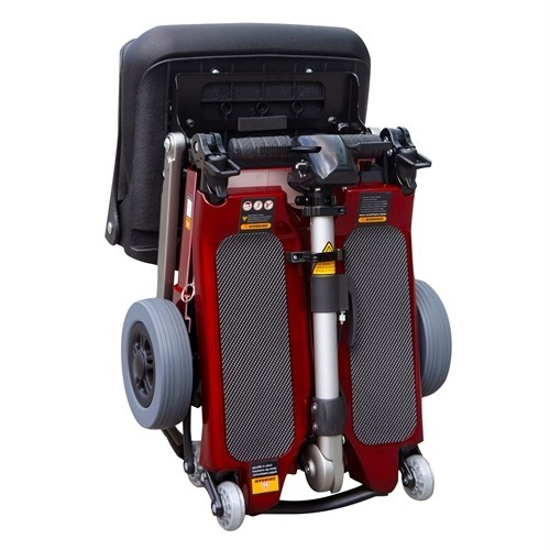 Folded red FreeRider Luggie Standard Folding Mobility Scooter