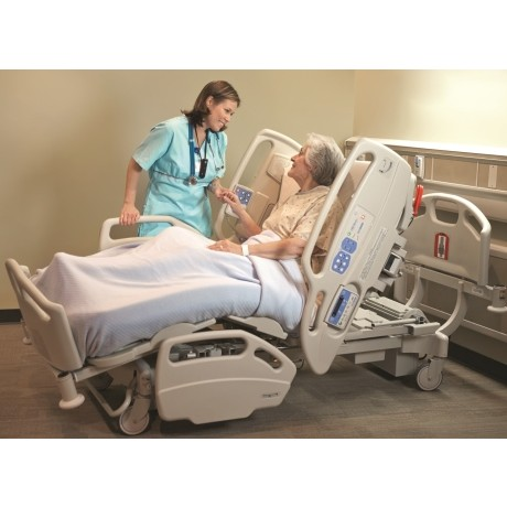 Woman laying in a Hill-Rom CareAssist ES Hospital Bed Rental
