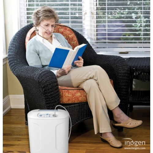 Woman reading while using a Inogen At Home Oxygen Concentrator