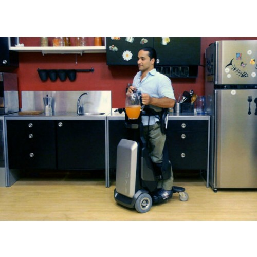 Man standing on a Matia Robotics TEK RMD in the Kitchen