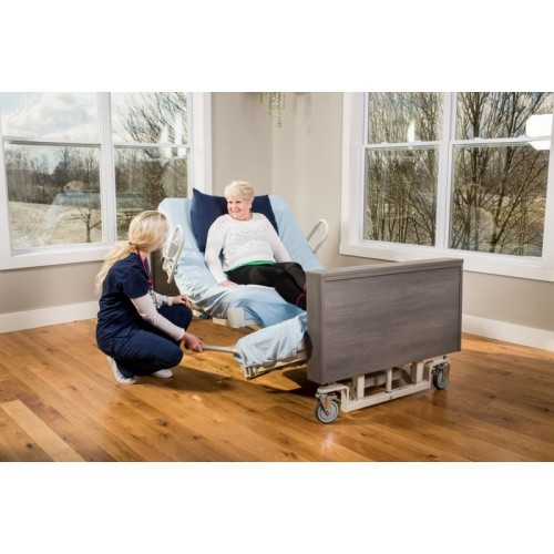 Woman laying in Med Mizer Pivot Bed PR8000