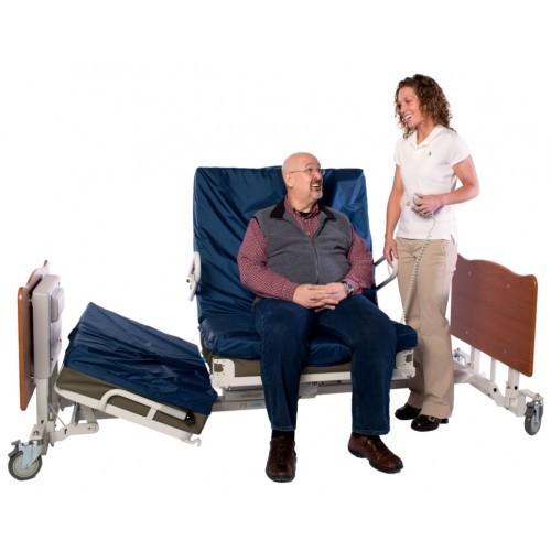 Man sitting in Med Mizer Pivot Bed PR8000