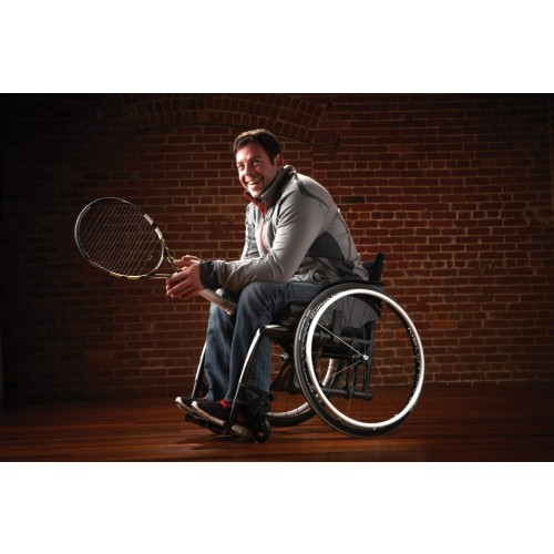 Man sitting in Motion Composites Veloce Ultra Lightweight Wheelchair