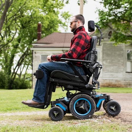 Man sitting in Permobil M5 Corpus Mid Wheel Power Wheelchair