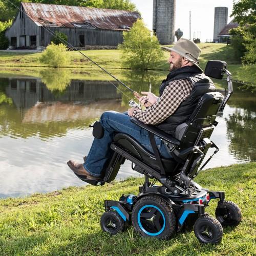 Man sitting in Permobil M5 Corpus Mid Wheel Power Wheelchair fishing
