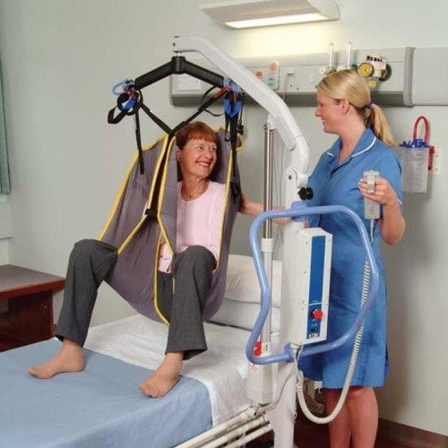 Man sitting in Sling of Portable Power Electric Patient Lift Rental