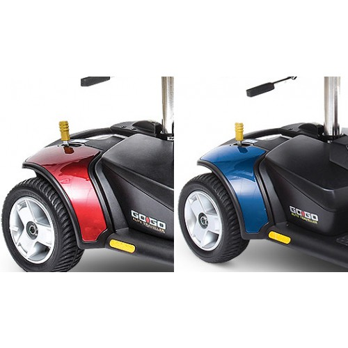 Closeup of Wheels of Red and Blue Pride Go-Go Elite Traveller 4-Wheel Mobility Scooter