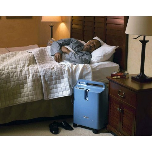Man sleeping using a Respironics Everflo Q Stationary Oxygen Concentrator