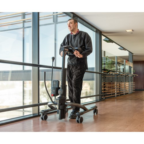 Man standing in Rifton Tram Lift (Gait Trainer & Sit-To-Stand Lift) Rental