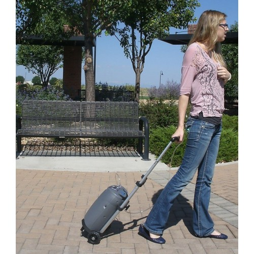 Woman walking with a SeQual eQuinox™ Portable Oxygen Concentrator