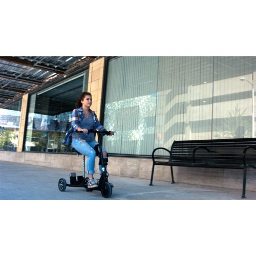 Woman sitting in SNAPnGO Electric Travel Mobility Scooter